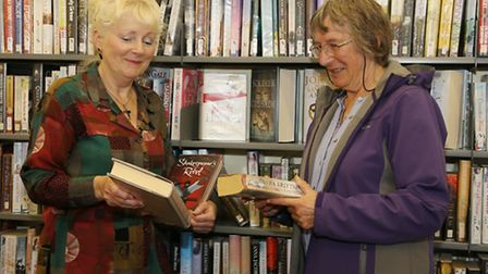 Denise Challenor who has worked at Arnside Library for the past 12 years with regular customer Jean