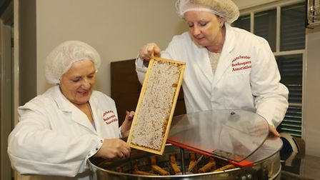 Joy Jackson and Lena Crowe of Manchester and District Bee Keeping Association with the honey extract