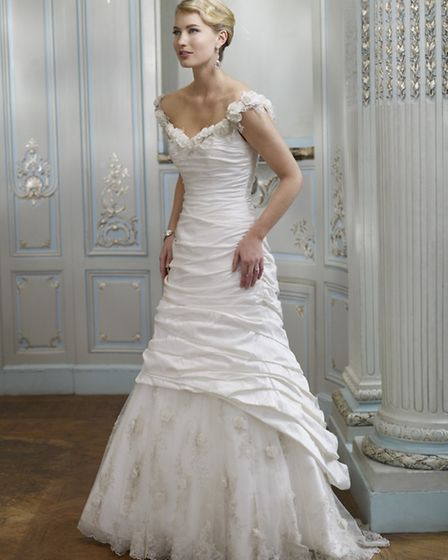 Could this be the perfect spring gown? The floral neckline and pretty layering of Eden, £2,058, by