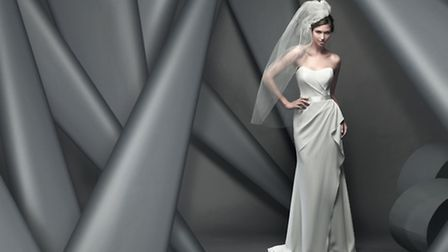 Fitzrovia - a stunning strapless gown in ivory crepe with a fitted bodice, sash detail and ruching t