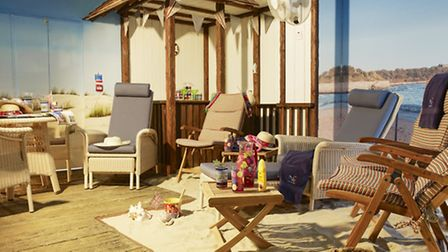 The sun room at Newstone House with real sand, sunlamps and a gentle coconut scented breeze!