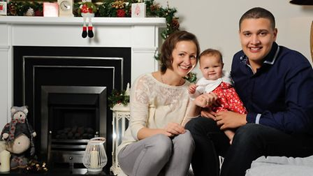 At home with BBC Radio Norfolk Presenter Nick Conrad with his wife Emma and 7 month old girl Erin.