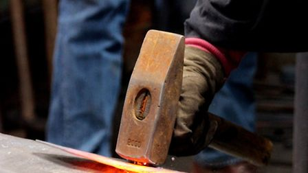 Hammering the basic blade shape with an anvil