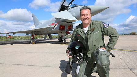 Mark Bowman, Test Pilot for BAE Systems, with a Typhoon Jet at Warton