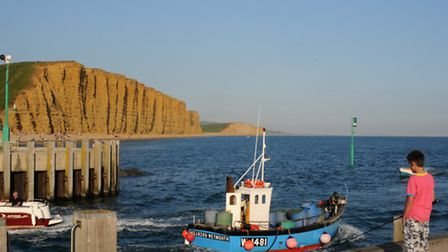 The distinctive golden cliffs of West Bay which play a starring role in Broadchurch © VisitEngland I
