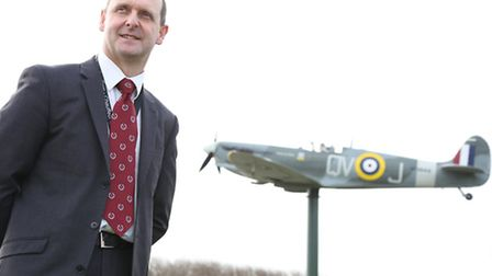 John Coombes in front of the Spitfire Memorial at Fairhaven Lake