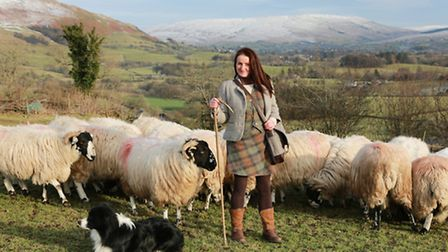 Shepherdess Alison O'Neill wearing examples of her tweed fashions with some Rough Fell Sheep at Shac