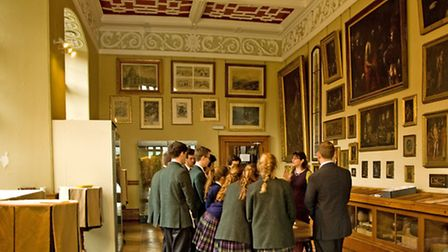 Pupils learning about the schools collections
