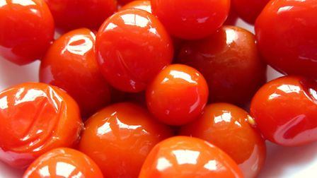Cherry tomatoes: add that dressing and basil for a quick and easy treat