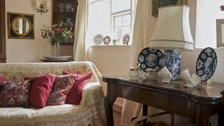 A pair of antique French mirrors lends an air of opulence to this delightful sitting room, whilst a