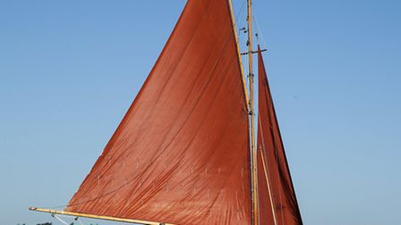 Setting sail on clear open water in the Broads.