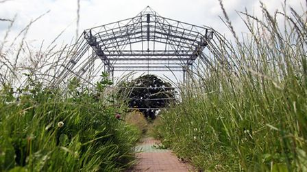 In front of the skeleton of the main Pyramid Stage at the Glastonbury Festival site at Worthy Farm,