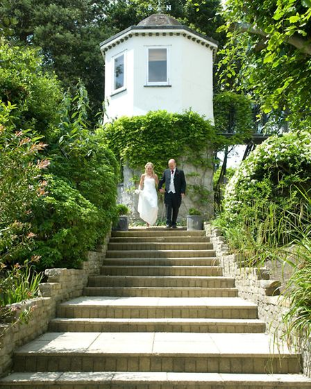 Couple outside the Lookout Tower - a romantic folly set in the gardens at the Alexandra
