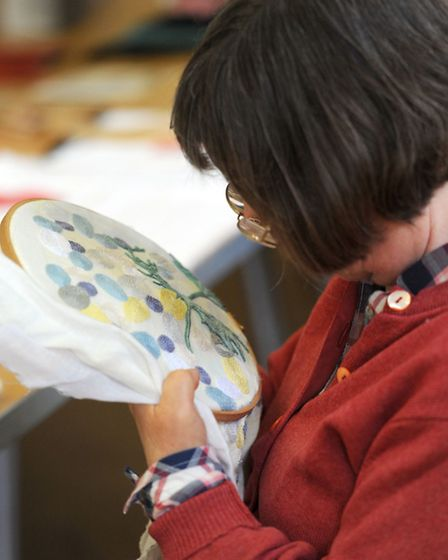 The Chain Reaction textile artists group at Fornham Village Hall. Sally Mills at work.