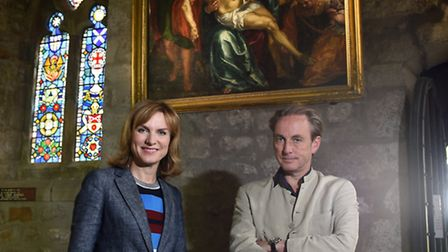 Fiona Bruce and Philip Mould in front of the cleaned painting before it was removed