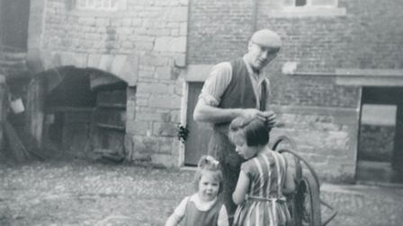 A childhood image of Catherine on the farm