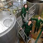 Hawkshead Head Brewer Matt Clarke (on steps) and his team in the brewhouse