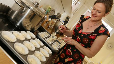 Gaynor Doyle preparing the batch of cupcakes ready for the oven