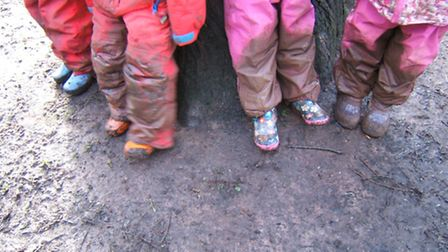Muddy boots at Nynehead Forest School - gardening happens in all weathers!