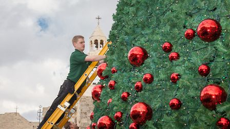 One of the Wavertree team hanging baubles in Bethlehem