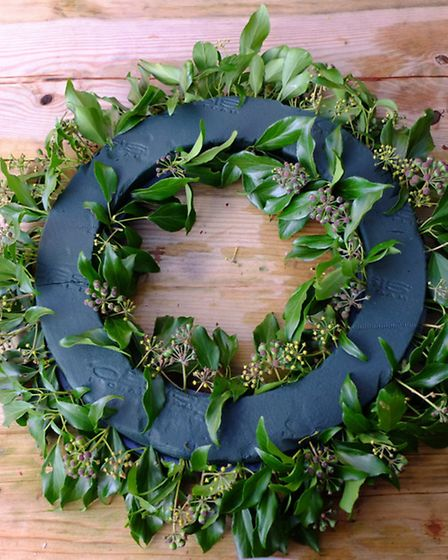 When you cover the inside edge of your wreath ring, the foliage here will need to be slightly shorte