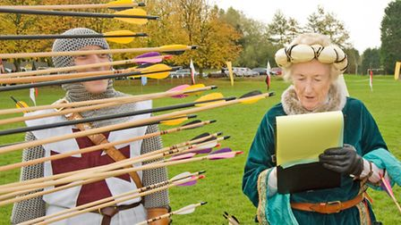 Gladys Kay, checking scores with her mediaeval clipboard