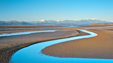 A stunning view of the north end of Morecambe Bay with the Lake District peaks in the background ©