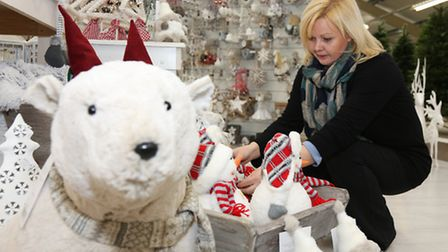 Julie Donnelly arranging the display in the Nordic themed range