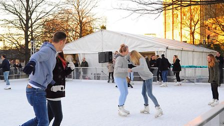 Fun on the ice rink in the Castle Mall gardens, next to Norwich Castle. Picture: Denise Bradley