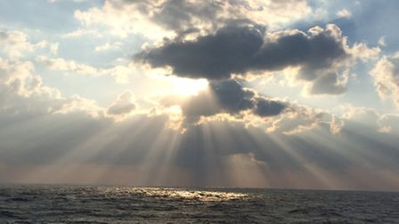 Ray of sunshine, the sun peeping out from the clouds on a windy day at Thorpeness. Taken by Sally Ol