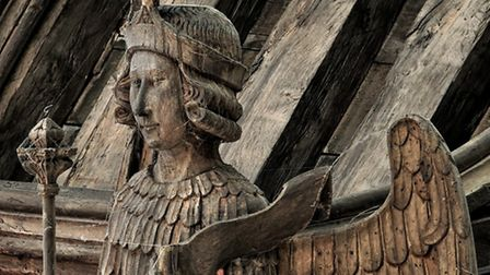 Feathered friend: An archangel clad in a suit of feathers in the nave roof at St Mary's Bury St Edmu