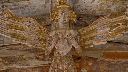Gilded and gorgeous: An angel at Holy Trinity Blythburgh where much of the original roof colour surv