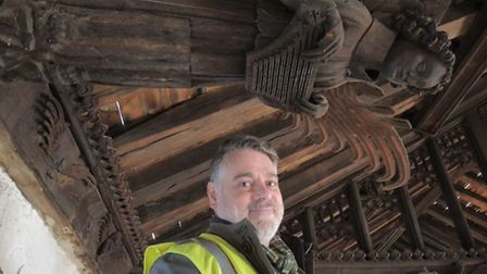 The author Michael Rimmer in the roof of St Nicholas Chapel at King's Lynn, the earliest dateable an
