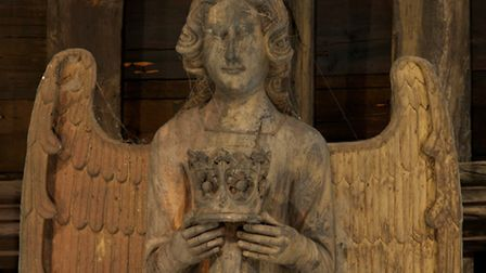 Fit for a queen: A female angel at St Mary's Bury carries a crown. It's thought she may represent Ma