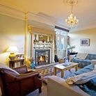 SITTING ROOM: Sofas from The Sofa Shop 01282 412888. Fireplace is original. Curtains and Throws from
