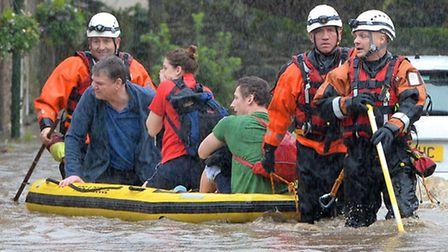Rescued residents on a flooded King St, Whalley © WARREN SMITH 2015.