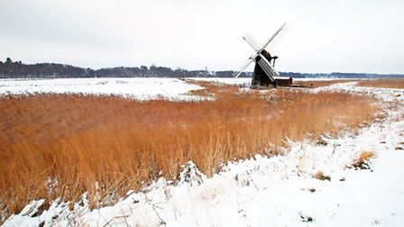 Herringfleet Mill standing proudly in a winter landscape