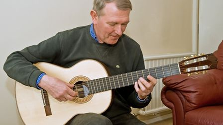 John playing a newly completed guitar to check all is correct
