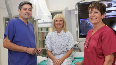Consultant Cardiologist, Dr Talwar and Cardiac Services Manager, Norma Cox with a patient at Nuffiel
