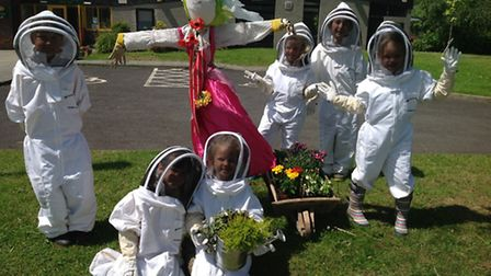 Some Manor Road pupils in their bee keeping outfits