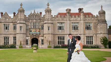 Amie and James Roller outside the stunning Hengrave Hall, on their wedding day. Picture by Sonya Dun