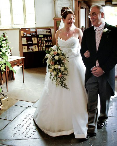 Pictured are Natasha Easter and her dad Tony Easlea at her wedding at Dereham's St Nicholas Church.