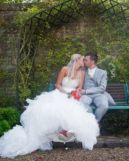 A romantic moment at Neil and Lauren Thomson's wedding at Hoveton Hall