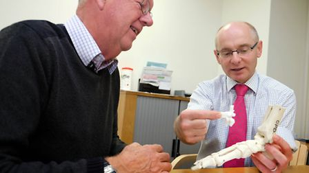 Nuffield Health Consultant Orthopaedic Surgeon Mr HeathTaylor show patient, Mr Garside, a replacemen