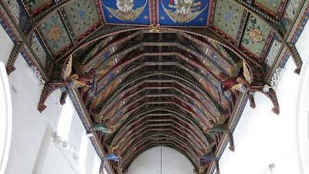 The chancel (foreground) and nave ceilings, painted by the Rector's wife, Mrs. Mildred Holland, betw