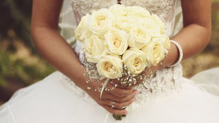 More brides-to-be than ever are choosing to deck out their nuptials in fake flora (Getty Images/iSto