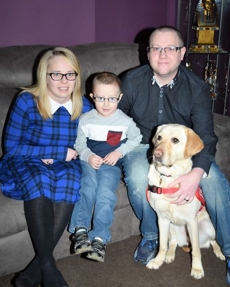 Chris with wife, Sam, son Jayden and detection dog Jade