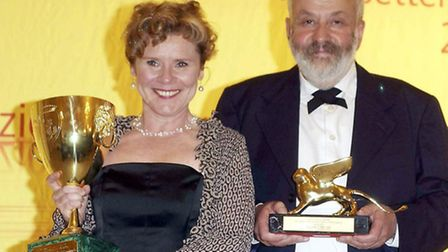 AFP, AP & EPA OUT Actress Imelda Staunton and director Mike Leigh with their awards during the closi