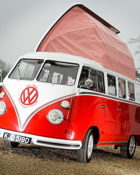 A VW camperva from Retro Campers Norfolk parks up on the Norfolk coast