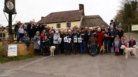The villagers celebrate the saving of the Drovers Inn